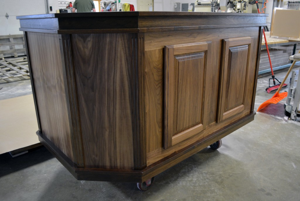 Black walnut cabinetry set for octagonal shaped tank, clearcoated