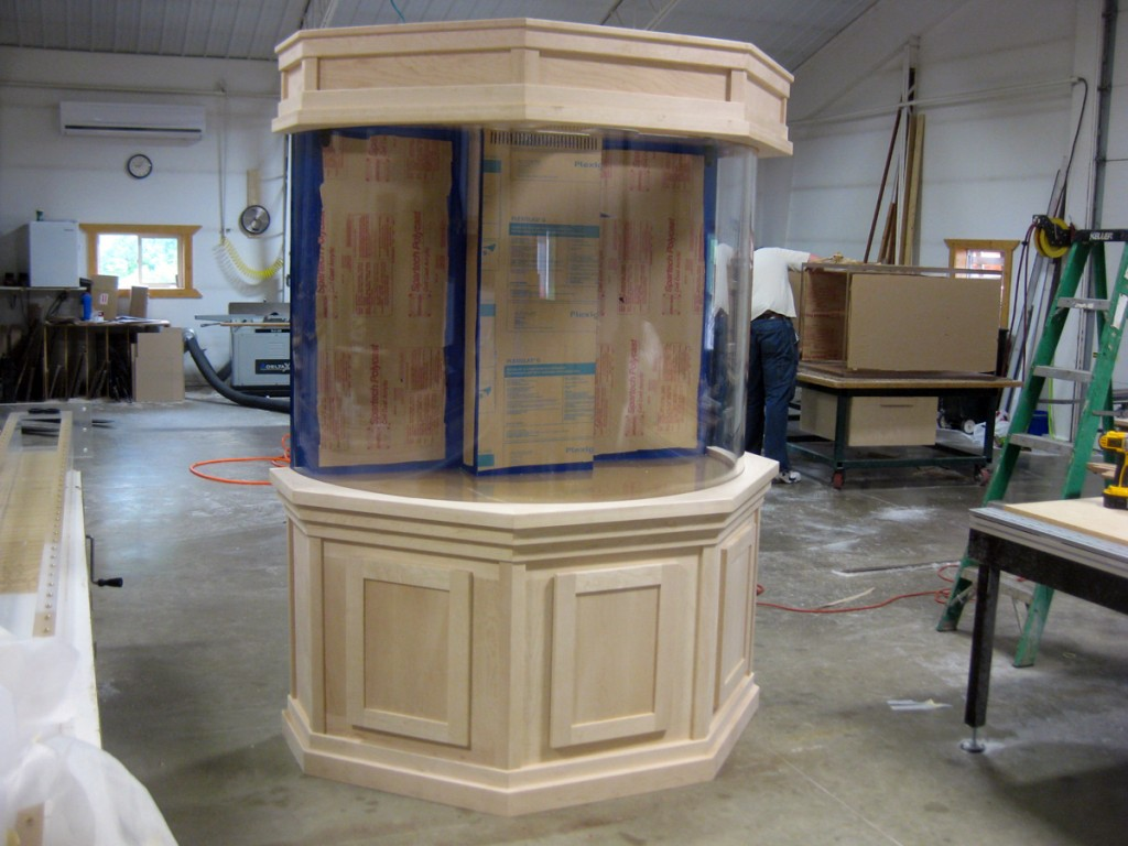 Flat panel maple cabinetry for curved aquarium, unfinished