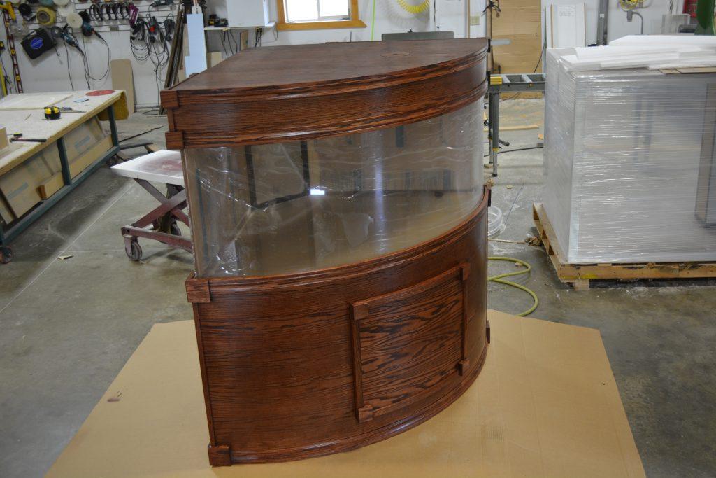 Oak cabinetry set for larger quarter cylinder